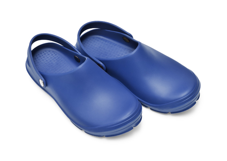 Crocs shoes. A pair of dark blue clogs isolated on white background w/ path