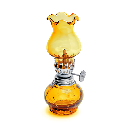 Oil lamp wick lantern made of yellow glass and metal isolated on white background