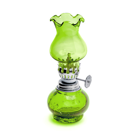 Oil lamp wick lantern made of green glass and metal isolated on white background Reklamní fotografie