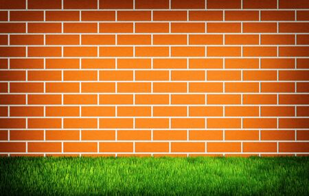 Brick wall with green grass at the bottom Reklamní fotografie