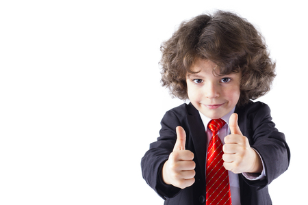 Cute curly little boy stretched out his arms forward, and showing gesture Very good. White background.