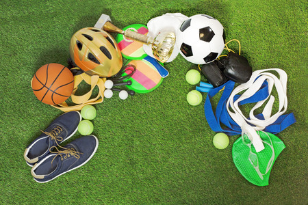 Many Sports, equipment for training and stuff on green grass. Background with space for text or image.