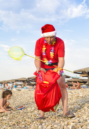 Mad Santa with bag on the beach