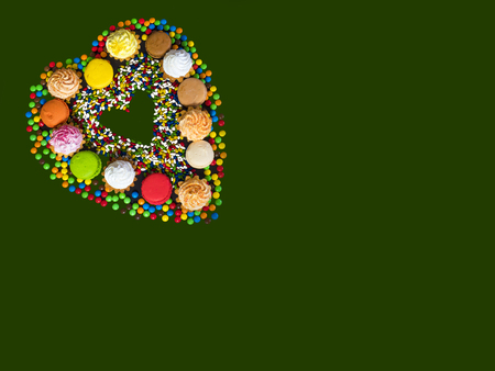 Collage of different desserts. Sweets. Green background.