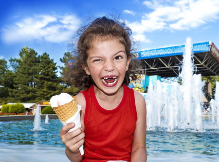 Happy little boy with ice cream. The concept of emotions.