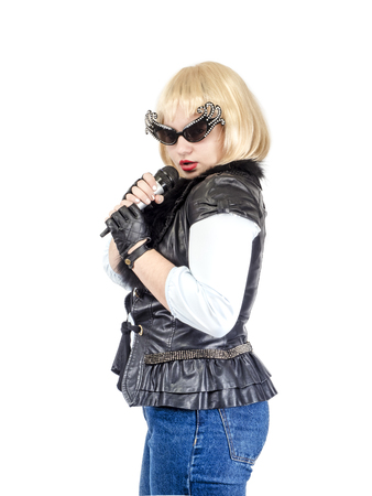 A semi-long portrait of a female rock musician in a black leather jacket and gloves on a white background. The concept of music and rock style