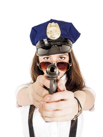 Beautiful young girl with a gun, isolated on white background. A teenage girl is holding a gun in her hands.