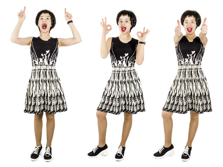 Woman in black and white dress in the concept of demonstrating success by gesturing okay on a white background