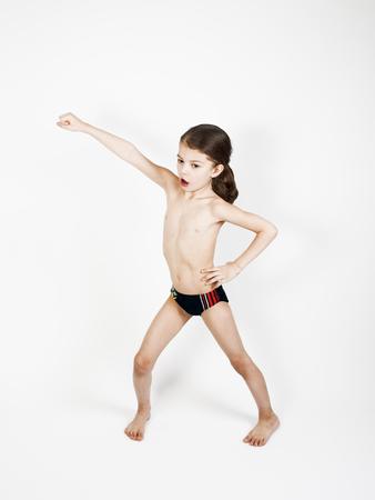 Superhero kid against a light background. Sport power concept Reklamní fotografie
