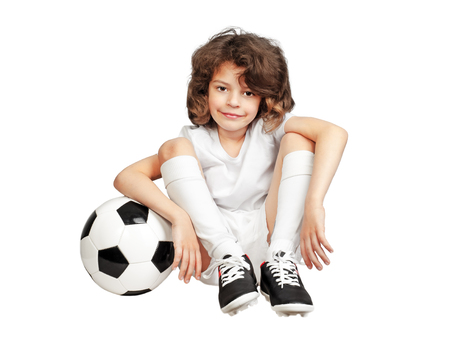 kid boy with soccerball over white background Фото со стока