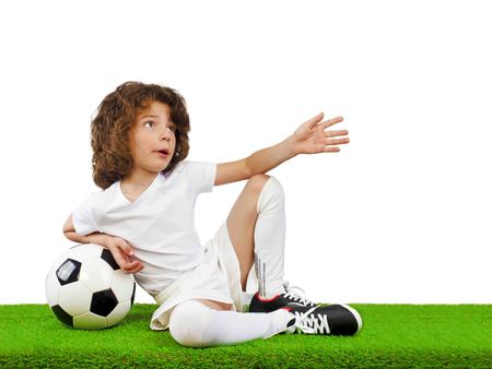 Young shocked European boy, fan or player in white uniform with soccer ball, cheer favorite football team isolated on white background. Sport play football, lifestyle concept. Isolated on white