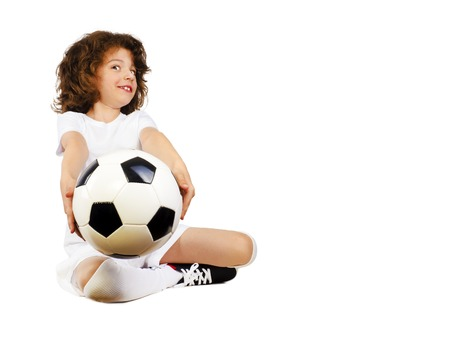 Handsome long-haired guy giving a soccer ball. Isolated on white