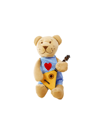 Happy cute brown teddy bear playing the balalaika. Isolated on white