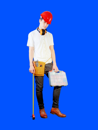 Full length portrait of a male builder over a blue wall background. repair, construction, building, people and maintenance concept. 版權商用圖片 - 106182383