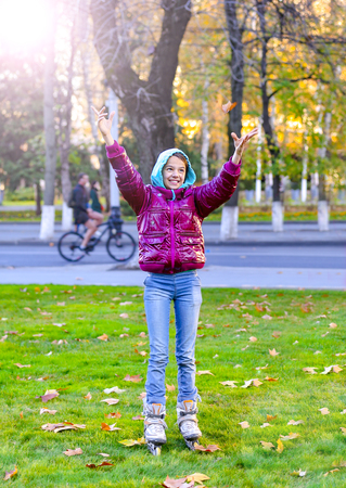 Happy child throwing leaves in autumn park Banco de Imagens