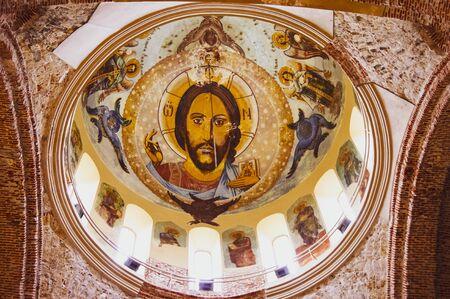 PITSUNDA, ABKHAZIA - January 05, 2013: Interior of Church with the fresco of Jesus..