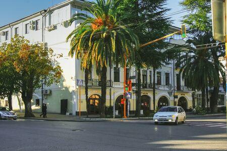 Sukhum, Abkhazia, - 03 January, 2013: City street with cars, palm trees.