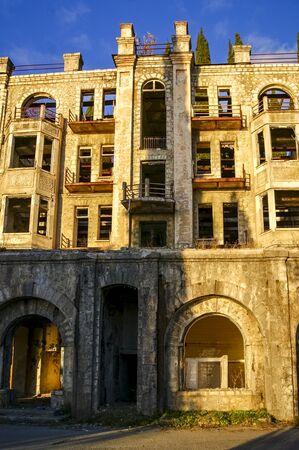 Sukhum, Abkhazia, - 03 January, 2013: Overgrown ruins of abandoned mansion in Abkhazia. Abandoned villa in the forest in Abkhazia Редакционное