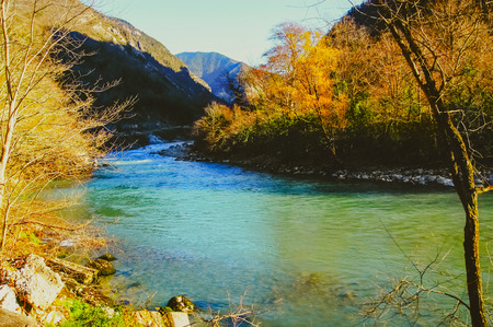 River in the mountains of Abkhazia. Beautiful mountain river with turquoise color water flowing down the gorge 版權商用圖片