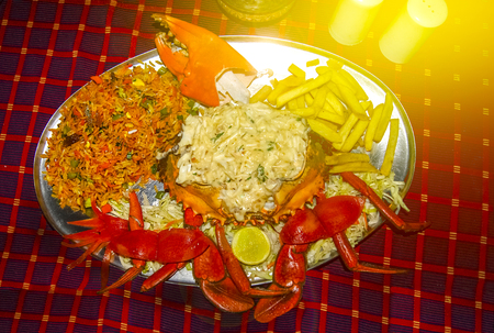 Chilli mud crab masala curry with brown, red, matta rice, Kerala Goa fish curry cuisine India. Hot and spicy seafood dish prepared using Indian spices on banana leaf. Mangrove, Black, Giant crustacean