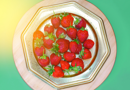 Healthy golden platter with ripe fruits, strawberries, top view, copy space