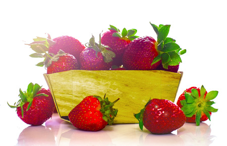 Delicious ripe strawberry in wooden basket isolated on white background Reklamní fotografie