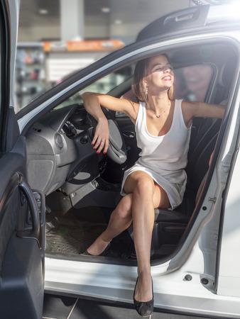 Woman buying the car. Lady in a car salon Reklamní fotografie
