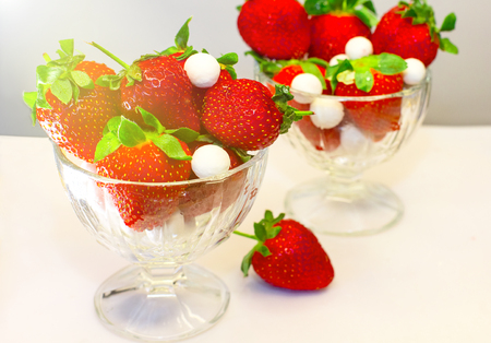 Strawberries in glass bowl standing on the table. Selective focus. Reklamní fotografie - 122504023