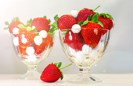 Strawberries in glass bowl standing on the table. Selective focus. Banco de Imagens