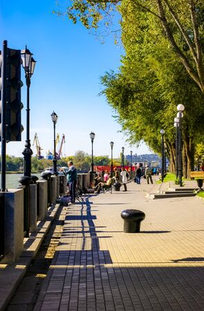 Rostov-on-Don,Russia - October 14,2012: Fishers on embankment of right side on river Don