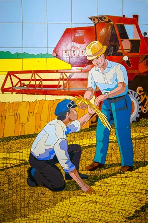 Rostov-on-Don,Russia - October 14,2012: The farmers in the wheat field. Rostov - painting by transitions. In the former USSR, mosaic was widely used to decorate cities.