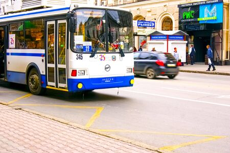 Rostov-on-Don,Russia - October 14,2012: Modern white with a blue stripe a trolleybus in the center of a large city carries passengers