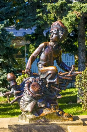 Rostov-on-Don,Russia - October 14,2012: Rostov-on-Don, Russia - October 2017: Metal sculpture of a boy on the embankment of a river in the city