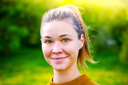Portrait of a smiling young woman in woodland Stock Photo