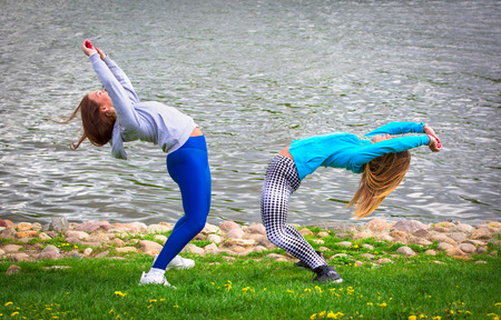 young girl goes in for sports in nature. healthy lifestyle.Warm-up on the shore of a natural pond, river, lake, sea