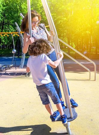 happy children at playground area in summer