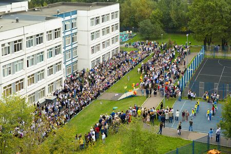 Russia, Moscow, September 3, 2018: The holiday began school. A lot of people on the school line. Birds-eye view