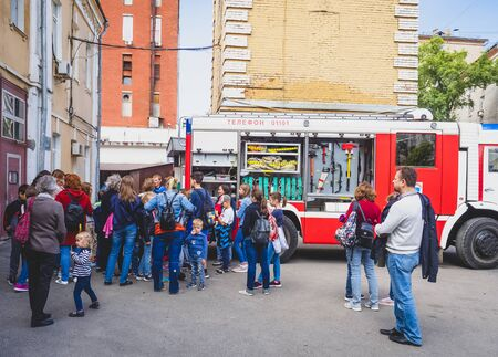 MOSCOW, RUSSIA - AUGUST 07, 2019: Fire Station One open family day tour. Excursion for students at the fire station
