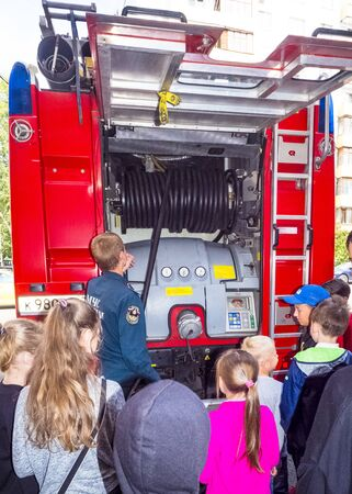 MOSCOW, RUSSIA - AUGUST 07, 2019: Fire station. A fireman explaining his job to children