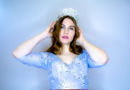 Woman wear jewelry crown and blue organza cascading dress. Beauty queen with glamor look in studio. Girl princess. Woman beauty, makeup and look. Fashion jewelry model in tiara.