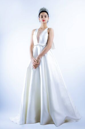 beautiful bride posing in white dress with wedding, isolated on a light background