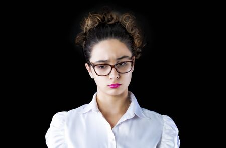 Young business woman wearing glasses who feels sad and pensive.