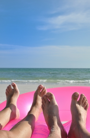 Two beach feet on pink ring photo