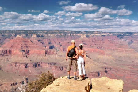 People look out on the Grand Canyon photo