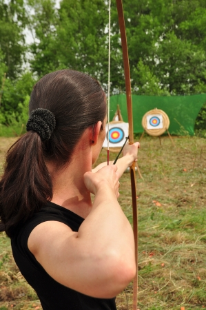 archery target: Young women training with the bow