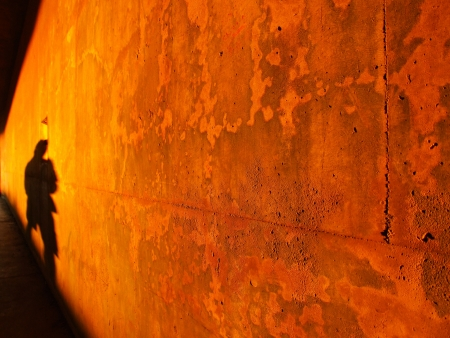 corrodet: Rusty wall red light background with shadow