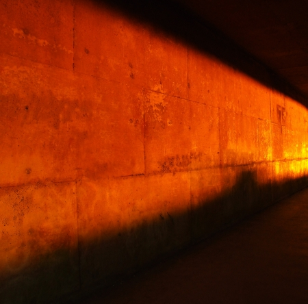 corrodet: Rusty wall red light background