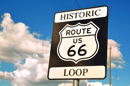 signaling: An old nostalgic route 66 sign and sky Stock Photo