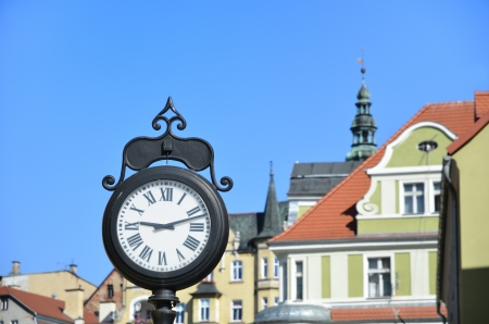Old clock in historic city  photo