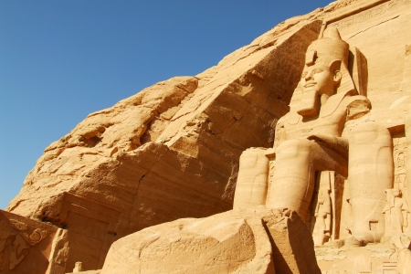 Statue near the entrance to Abu Simbel temple in Egypt photo